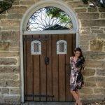 Historic St. Augustine, Florida brunette standing in front of historic door