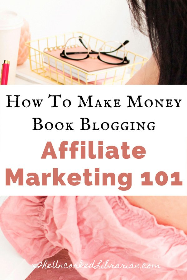 How To Make Money Book Blogging Affiliate Marketing 101 For Book Bloggers Pinterest Pin with image of a brunette woman in a pink shirt sitting at desk with a pile of pink books, reading classes, and computer and notebook open