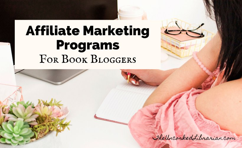Book Affiliate Programs For Book Bloggers Blog Post Cover with woman in pink shirt sitting at a computer with a stack of pink books and pen and notebook open