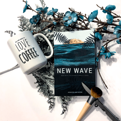 New Wave Bookstagram with book cover, flowers, coffee mug, and blush brushes