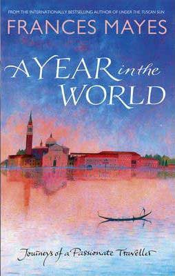A Year In The World by Frances Mayes book cover with pastel lake and old city in the background