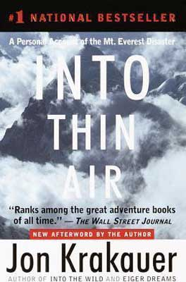 Survival books for dad, Into Thin Air by Jon Krakauer book cover with clouds and snow over Mount Everest