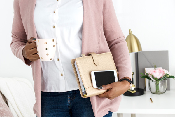 How to form LLC For bloggers with woman carrying mug of coffee, planner, and Iphone