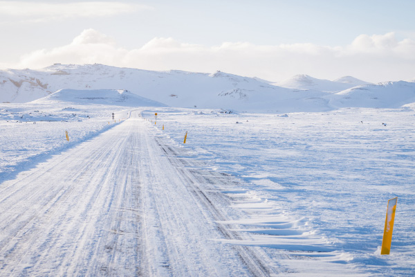 Yellow Poles Along Road While Driving In Iceland In Snow