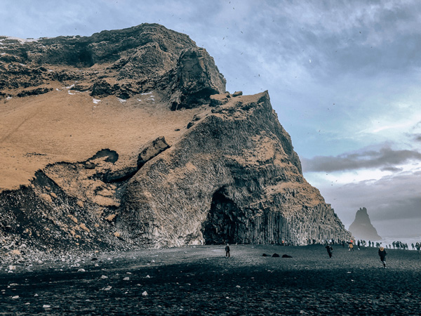 7  Day Iceland itinerary Reynisfjara black sand beach with rock formations and basalts