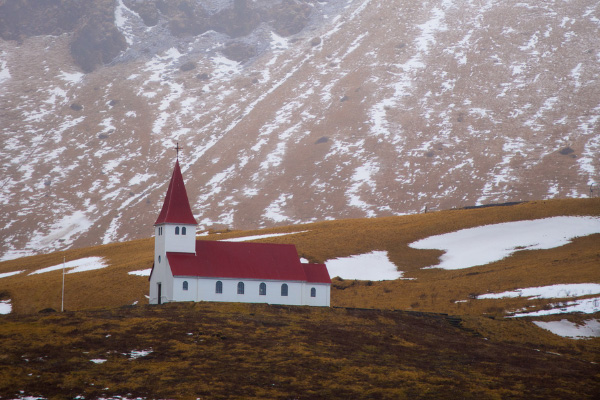 Red and White Church on a hill In Vik Iceland