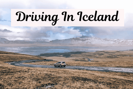 Car driving on an icy road while visiting Iceland in the winter