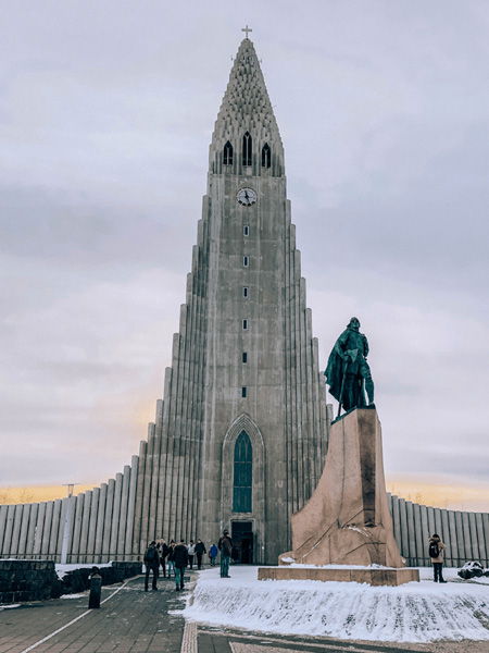 Hallgrímskirkja Iceland with triange shaped church and statue out front