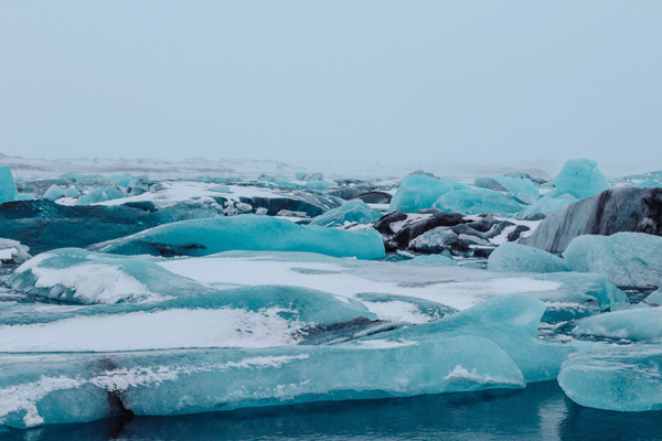 Iceland Itinerary 7 Days Jokulsarlon glacier lagoon with blue and white glaciers floating on water
