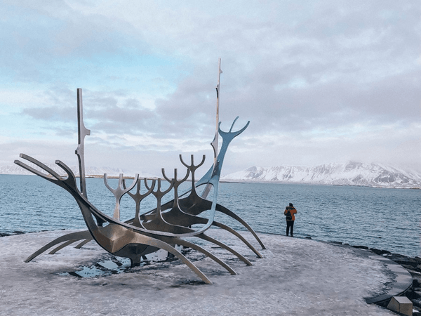 Spending a day in Reykjavik Solfar Sun Voyager Sculpture with Mount Esja in back ground