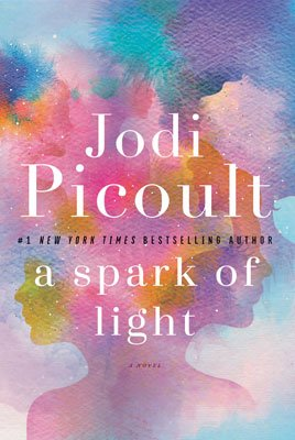 A Spark of Light by Jodi Picoult book review and book cover with pink and purple pastel blotches and shadow of two girls' faces back to back