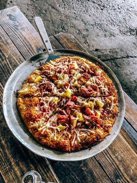 Asheville Pizza and Brewing Company gluten free pizza with vegan cheese
