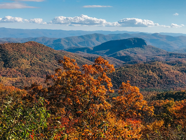 Blue Ridge Parkway Asheville NC during the fall with mountains and colorful trees