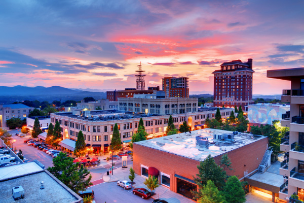 Moving To Downtown Asheville North Carolina with cityscape at sunset