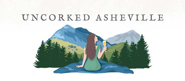 Uncorked Asheville Travel Blog Logo with brunette white woman holding white wine glass looking down on Blue Ridge Mountains and Asheville, NC
