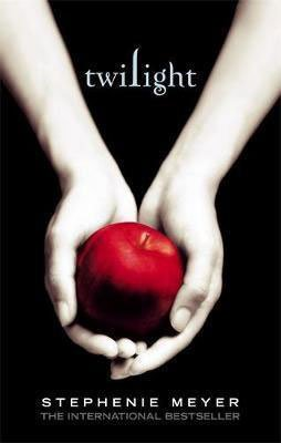 Twilight by Stephanie Meyer book cover with pale white arms holding a bright red apple