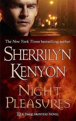 Night Pleasures by Sherrilyn Kenyon orange book cover with white man on a dark street-lit road