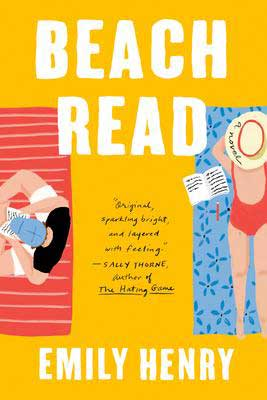 Beach Read by Emily Henry book cover with woman and man laying on beach towels with writing paper and pencils