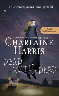 Dead Until Dark by Charlaine Harris purple book cover with cartoon vamp flying a blonde white woman over a burning house