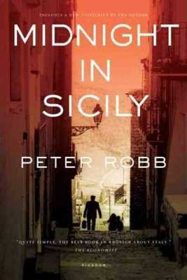Midnight In Sicily by Peter Robb book cover with orange sky and man walking down a narrow street in the shadows