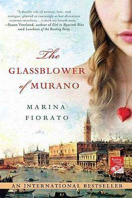 The Glassblower Of Murano by Marina Fiorato book cover with a young white woman wearing a red heart necklace and looking at Venice, Italy