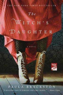 The Witch's Daughter by Paula Brackston book cover with bottom of person's legs in red garb with black rights and brown boots