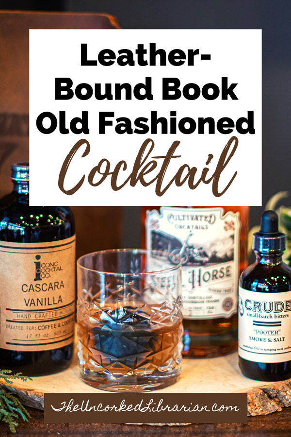 Leather Bound Book Smoked Old Fashioned Recipe Pinterest Pin with brown old fashioned, bitters, and whiskey