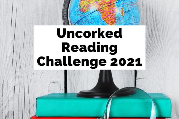 Uncorked Reading Challenge 2021 with globe on top of green and red books