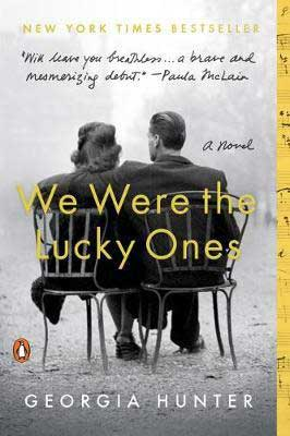 We Were The Lucky Ones by Georgia Hunter book cover with man and woman sitting on a bench
