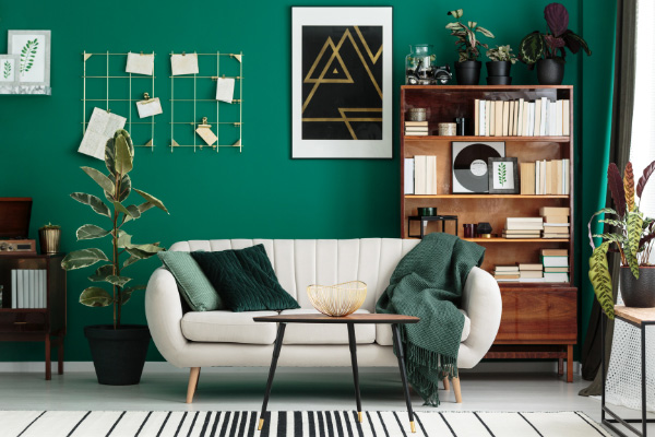 Book Blog Post Ideas Home Library Design with white couch, green walls, and bookshelf filled with books