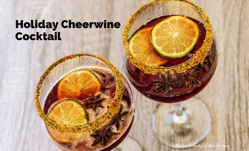 Holiday Cheerwine Cocktail Recipe with two large wine glasses filled with red punch and lime slices