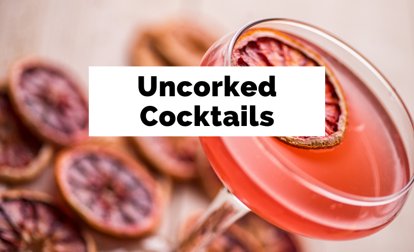 Uncorked Cocktails with pink drink and lemons