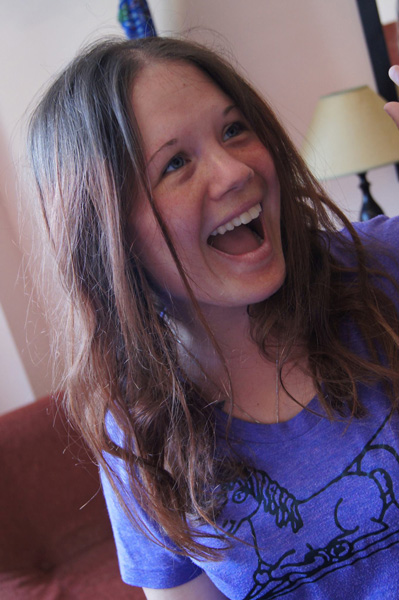 Writer Dagney McKinney white female with light brown hair wearing a purple shirt and smiling