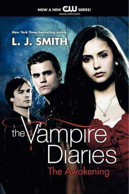 The Vampire Diaries: The Awakening by L.J. Smith book cover with 2 young pale men and one brunette woman in red shirt