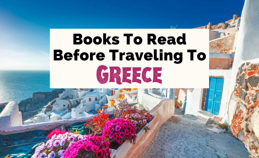 Best Books About Greece and Greek Books with picture of white and blue houses and alley in Santorini, Greece with pink flowers and blue water