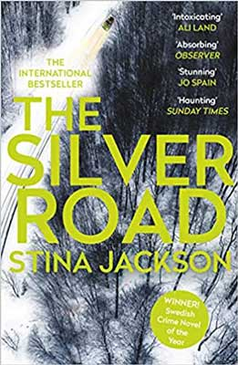 The Silver Road by Stina Jackson book cover with black and white forest