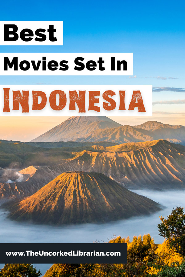 Best Movies Set In Indonesia Pinterest Pin with photo of Mount Bromo at sunrise with clear blue sky, water, and brown volcano craters